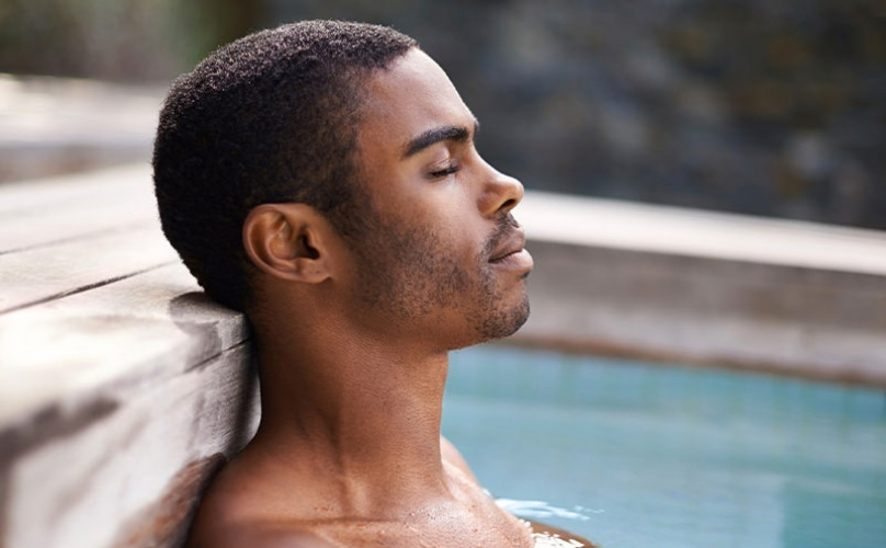 A man is relaxing in the pool