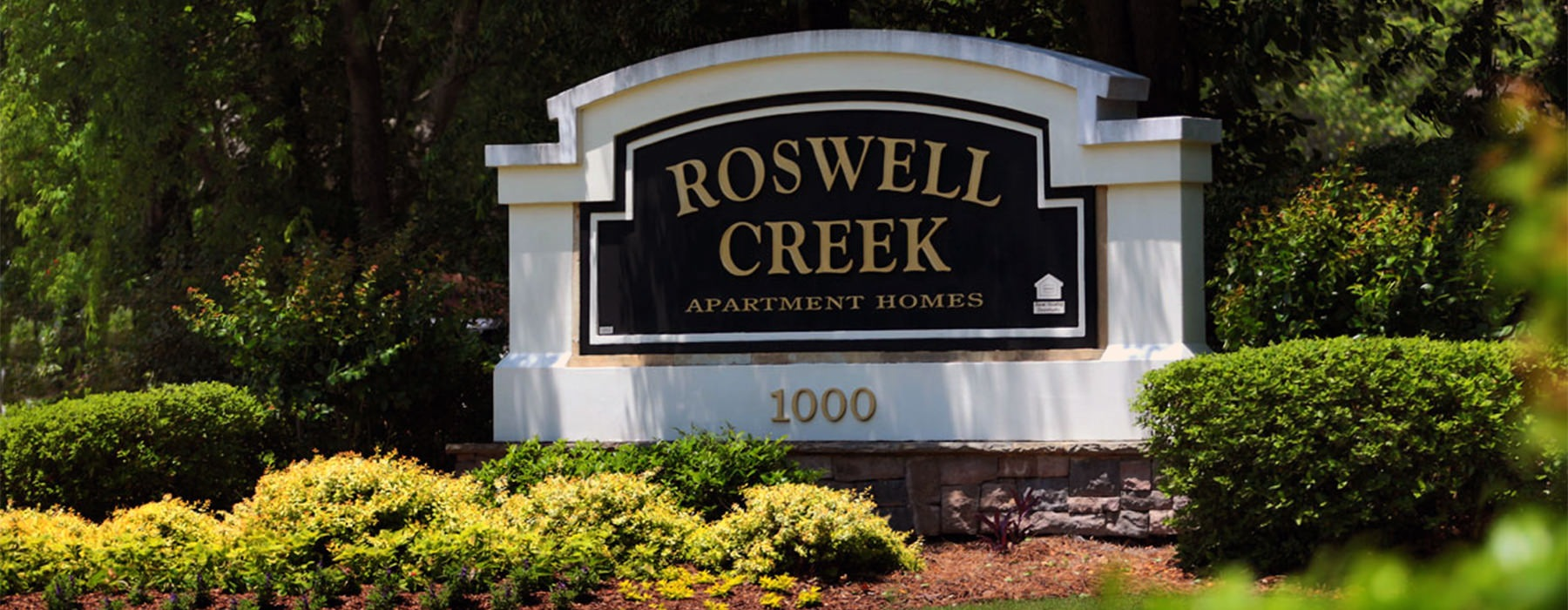 Roswell Creek Entrance sign with beautiful landscaping